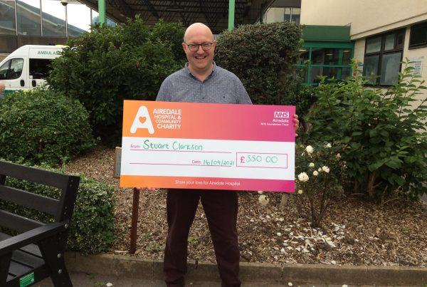 Stuart Clarkson donating the money he raised