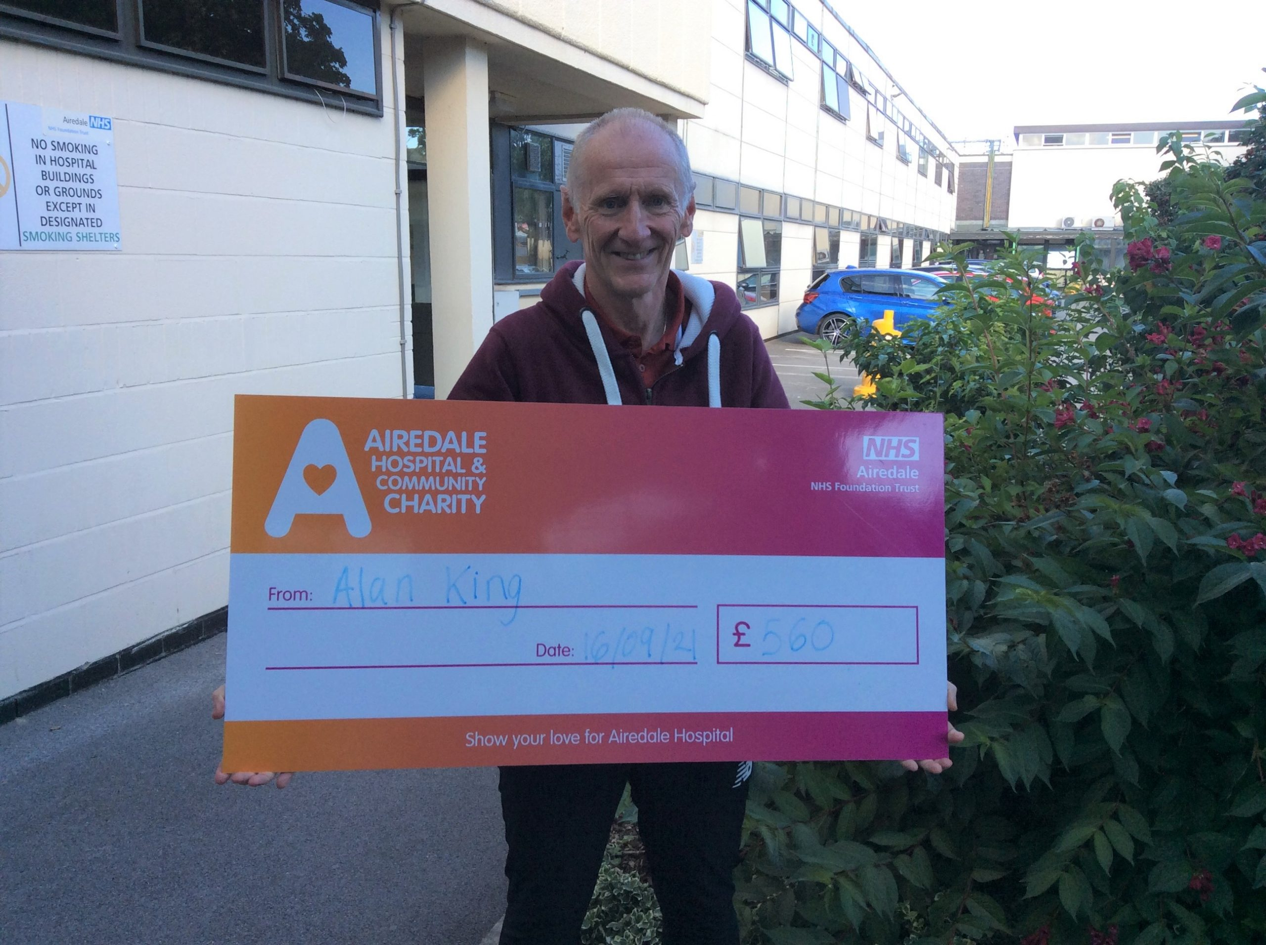 Alan King donating the money he raised for Airedale